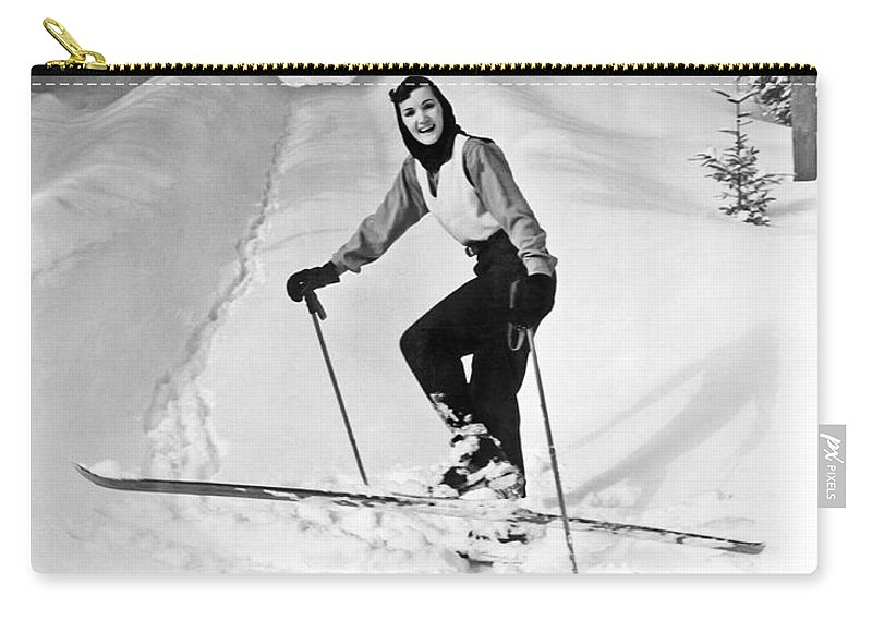 1956 Carry-all Pouch featuring the photograph A Woman Cross Country Skiing by Underwood Archives
