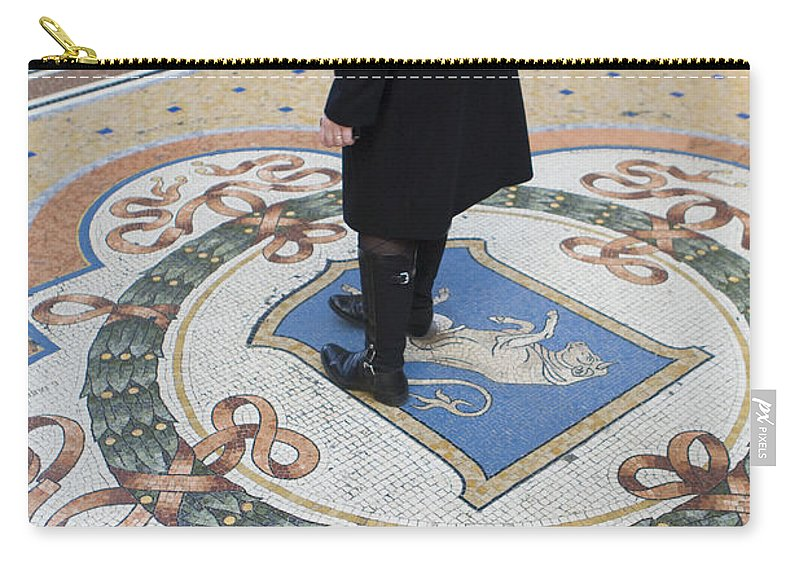 Travel Carry-all Pouch featuring the photograph A Woman Rubs Her Heel For Good Luck On The Crest Of The Bull In Galleria Vittorio Emanuele II by Jason O Watson