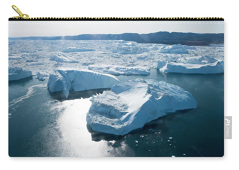 Melting Carry-all Pouch featuring the photograph Aerial Of Icebergs Of Ilulissat by Holger Leue