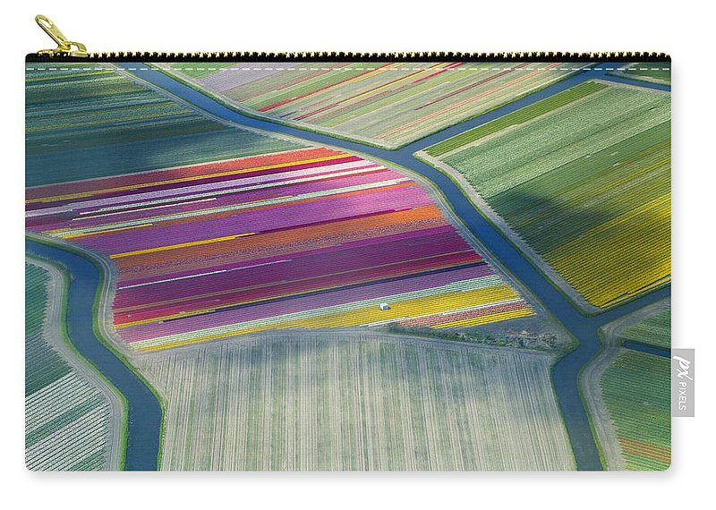 Curve Carry-all Pouch featuring the photograph Aerial View Of Flower Fields In Spring by Frans Sellies