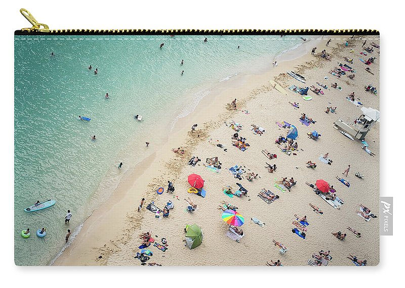 Honolulu Carry-all Pouch featuring the photograph Aerial View Of Tourists On Beach by Alberto Guglielmi