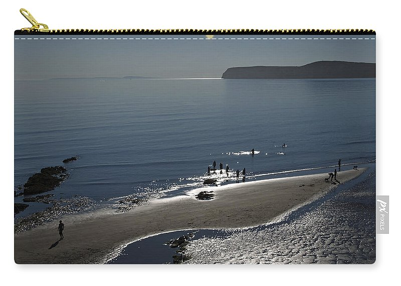 Britain Carry-all Pouch featuring the photograph Against The Light - Compton Bay by Rod Johnson