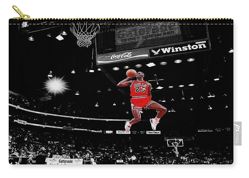 Michael Jordan Carry-all Pouch featuring the photograph Air Jordan by Brian Reaves