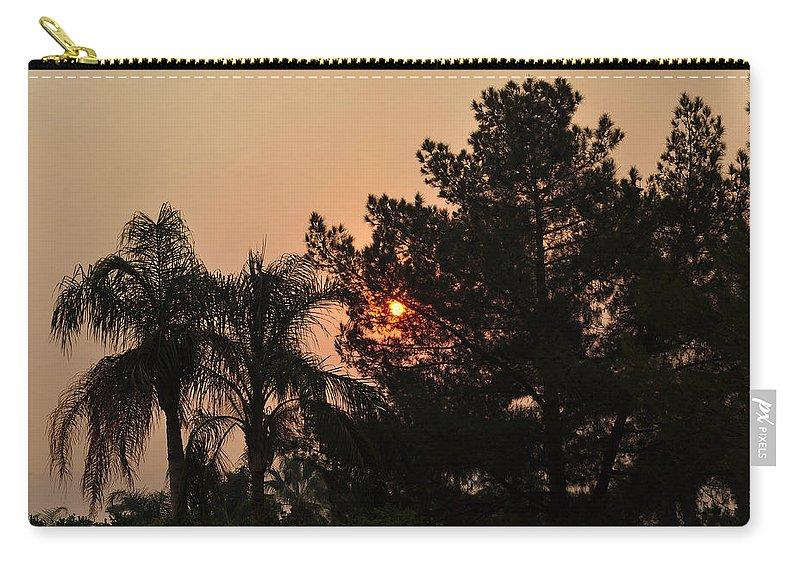 Clouds Carry-all Pouch featuring the photograph Almosts Gone Now Sunset In Smoky Sky by Jay Milo