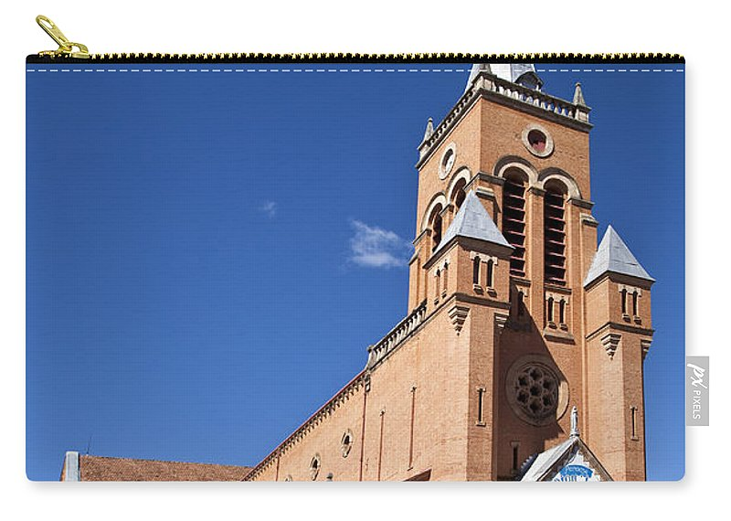 Roman Catholic Carry-all Pouch featuring the photograph Ambositra Rc Church Madagascar by Liz Leyden