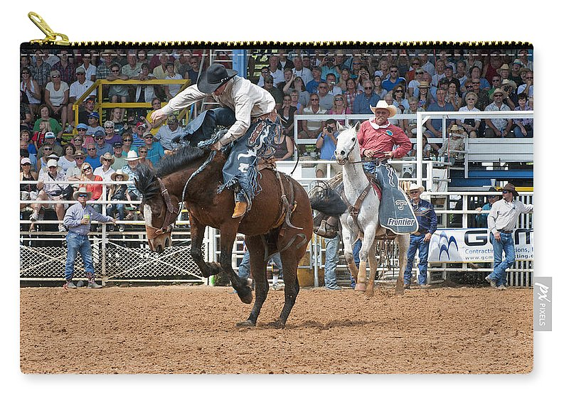 Rodeo Carry-all Pouch featuring the photograph American Cowboy Riding Bucking Rodeo Bronc II by Sally Rockefeller