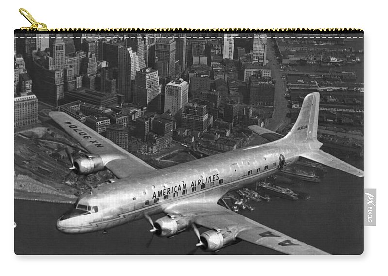 1035-207 Carry-all Pouch featuring the photograph American Dc-6 Flying Over Nyc by Underwood Archives