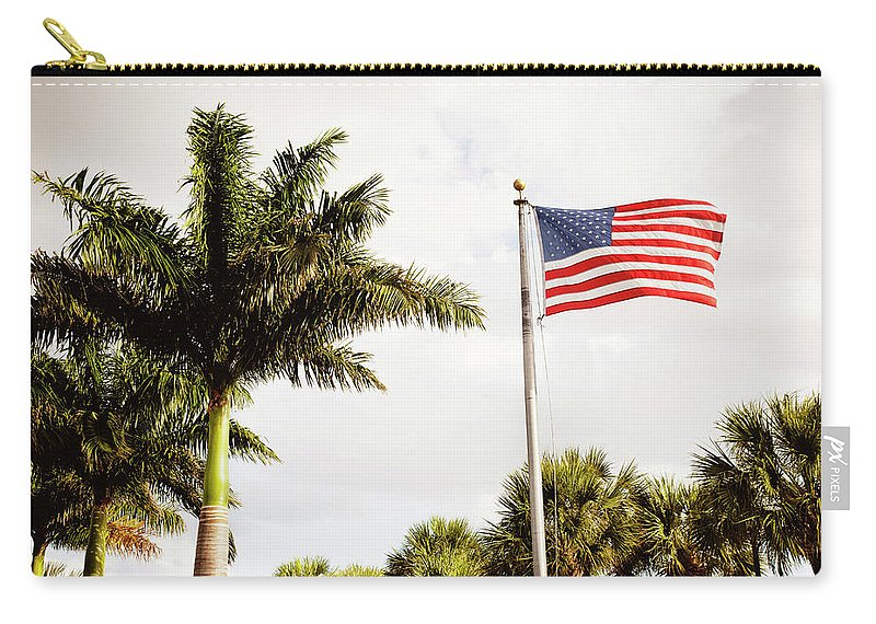 Tranquility Carry-all Pouch featuring the photograph American Flag Flying Amongst Palm Trees by Ron Levine