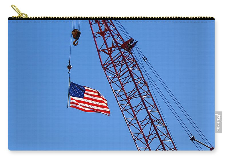 Flag Carry-all Pouch featuring the photograph American Flag On Construction Crane by Olivier Le Queinec