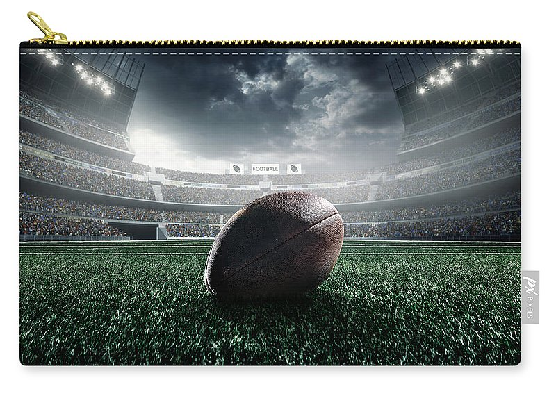 Event Carry-all Pouch featuring the photograph American Football Ball by Dmytro Aksonov