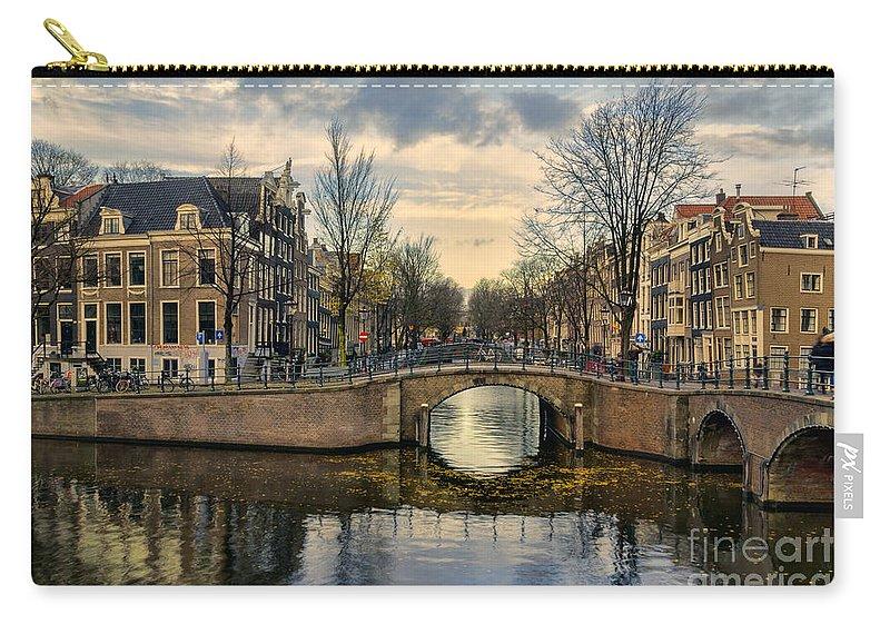 Amsterdam Carry-all Pouch featuring the photograph Amsterdam Bridges by Ann Garrett
