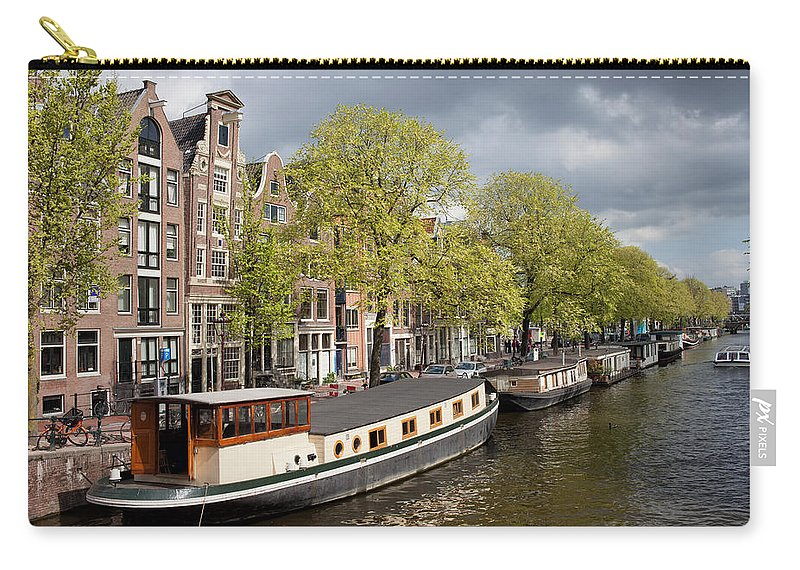 Amsterdam Carry-all Pouch featuring the photograph Amsterdam Canal Waterfront by Artur Bogacki