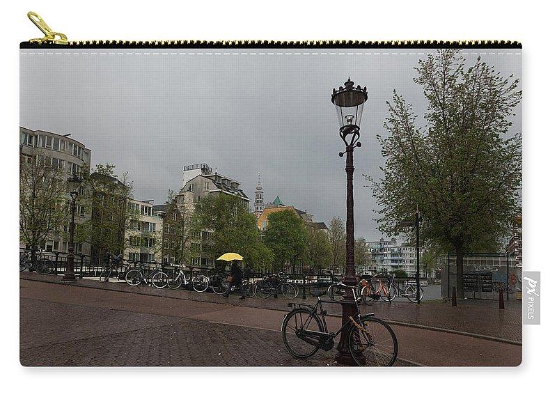 Georgia Mizuleva Carry-all Pouch featuring the photograph Amsterdam - The Yellow Umbrella by Georgia Mizuleva