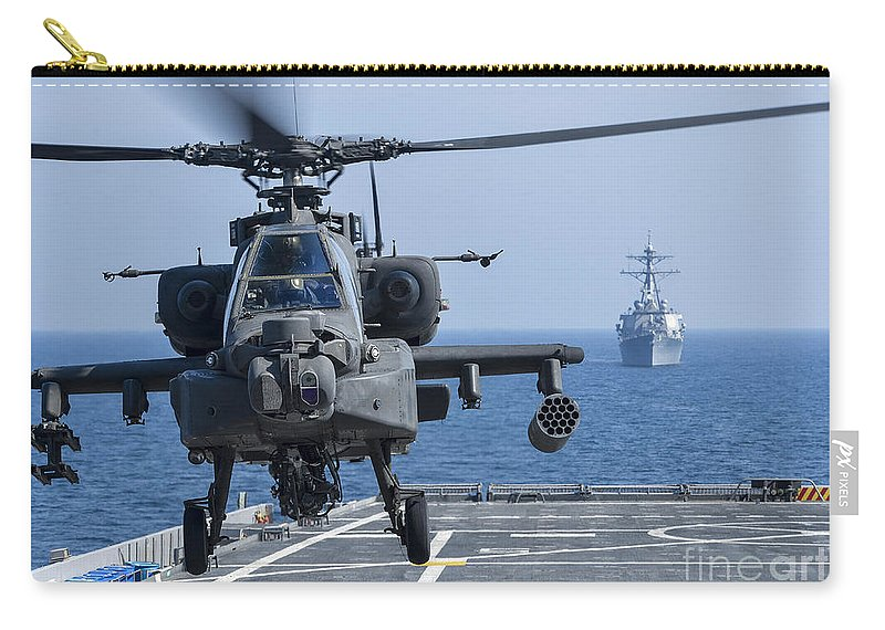 Military Carry-all Pouch featuring the photograph An Army Ah-64d Apache Helicopter Takes by Stocktrek Images