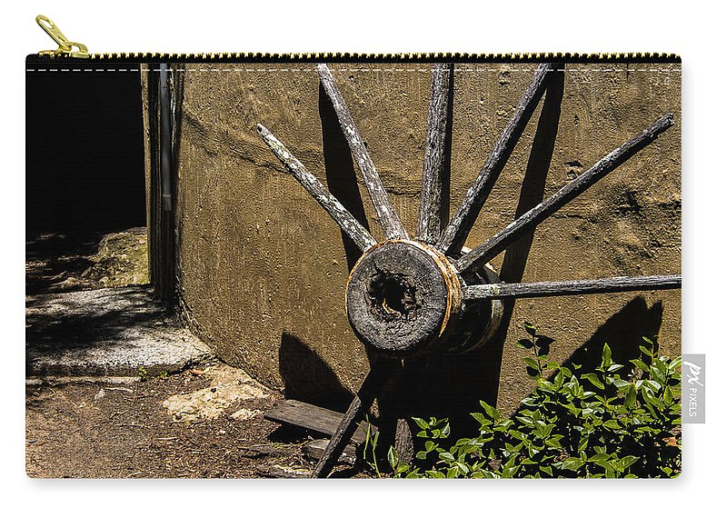 Wheel Carry-all Pouch featuring the photograph And There It Rests by Kaleidoscopik Photography