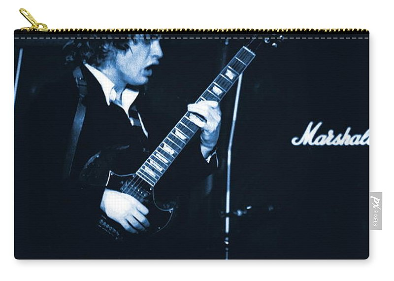 Angus Young Carry-all Pouch featuring the photograph Angus Chords Delight Crowds In Blue by Ben Upham