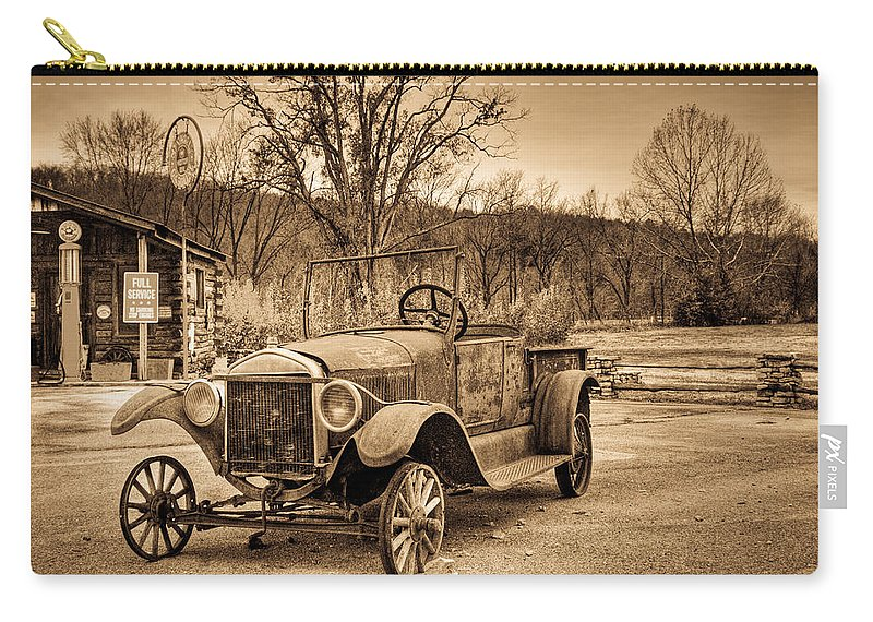 Antique Carry-all Pouch featuring the photograph Antique Car At Service Station In Sepia by Douglas Barnett