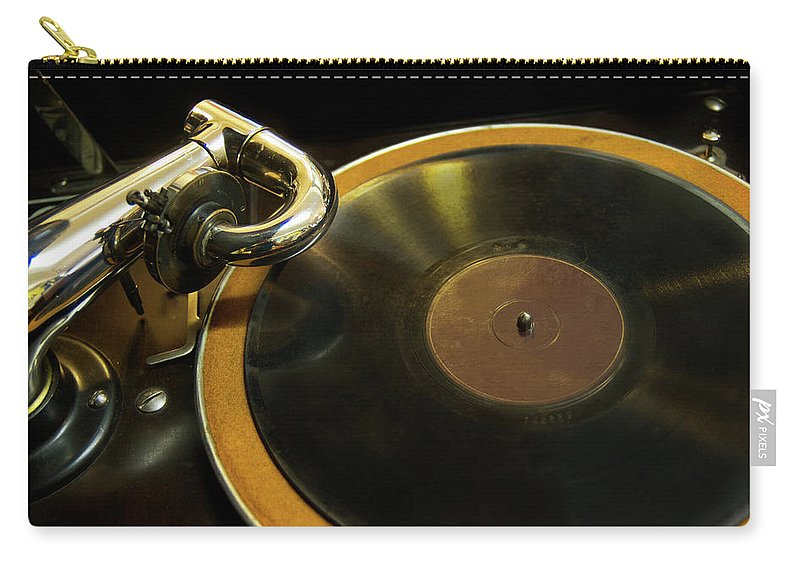 Music Carry-all Pouch featuring the photograph Antique Phonograph With A Record by Gregory Adams