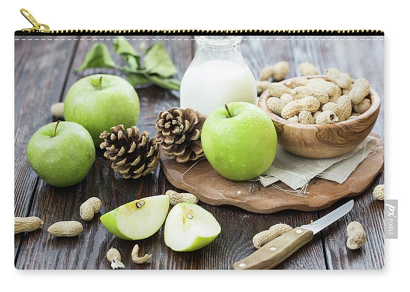 Breakfast Carry-all Pouch featuring the photograph Apples And Peanuts For Breakfast by Julia Khusainova