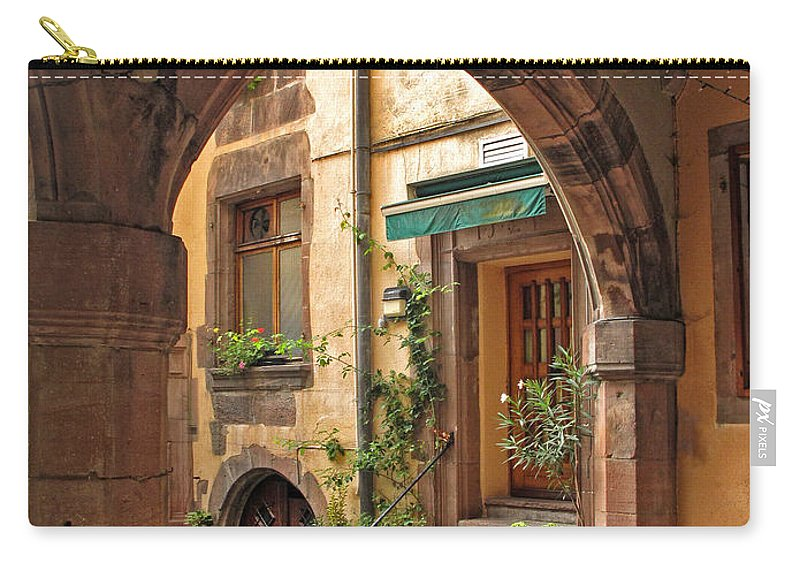 Kayserberg Carry-all Pouch featuring the photograph Arched Doorway In Kayserberg by Dave Mills