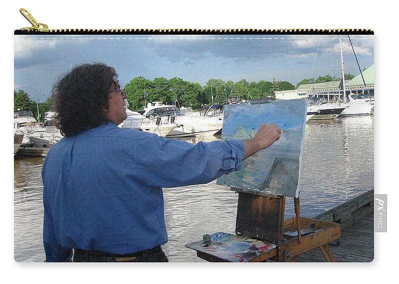 Ylli Haruni Carry-all Pouch featuring the photograph Artist At Work Port Credit Mississauga On by Ylli Haruni