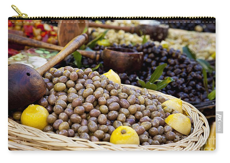 Olive Carry-all Pouch featuring the photograph At The Market by Brian Jannsen
