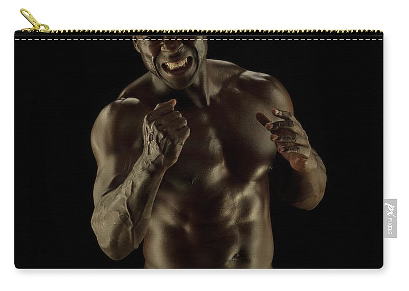 Toughness Carry-all Pouch featuring the photograph Athletic Female, Angry Shout, Clenched by Jonathan Knowles