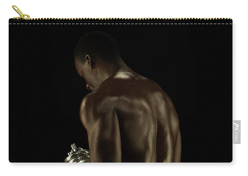 Mature Adult Carry-all Pouch featuring the photograph Athletic Male Exercising With A Hand by Jonathan Knowles