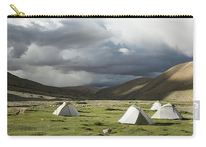 Tranquility Carry-all Pouch featuring the photograph Atmospheric Grassy Camping by Jamie Mcguinness - Project Himalaya