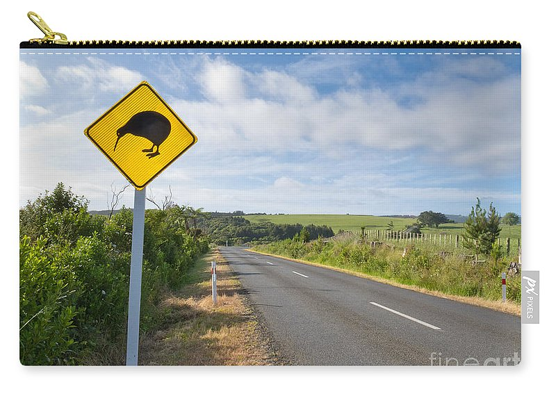 Animal Carry-all Pouch featuring the photograph Attention Kiwi Crossing Roadsign At Nz Rural Road by Stephan Pietzko