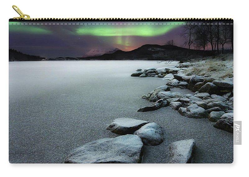 Aurora Borealis Carry-all Pouch featuring the photograph Aurora Borealis Over Sandvannet Lake by Arild Heitmann