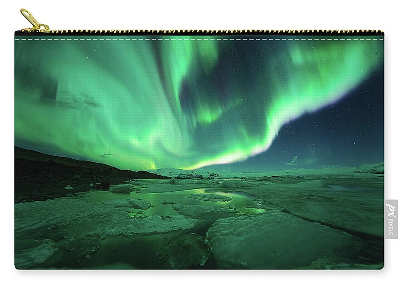 Glacier Lagoon Carry-all Pouch featuring the photograph Aurora Display Over The Glacier Lagoon by Natthawat