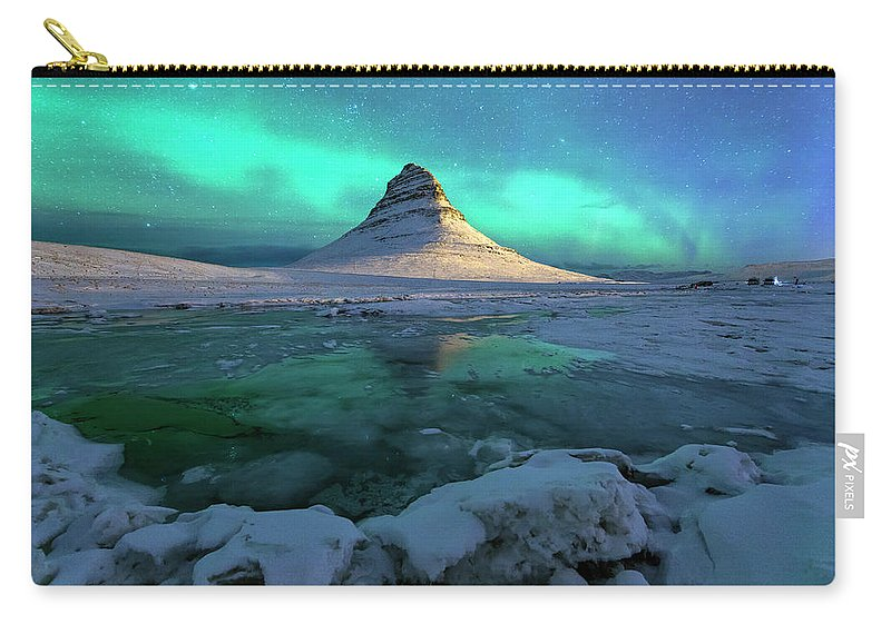 Tranquility Carry-all Pouch featuring the photograph Aurora Over Kirkjufell Mountain Iceland by Ratnakorn Piyasirisorost