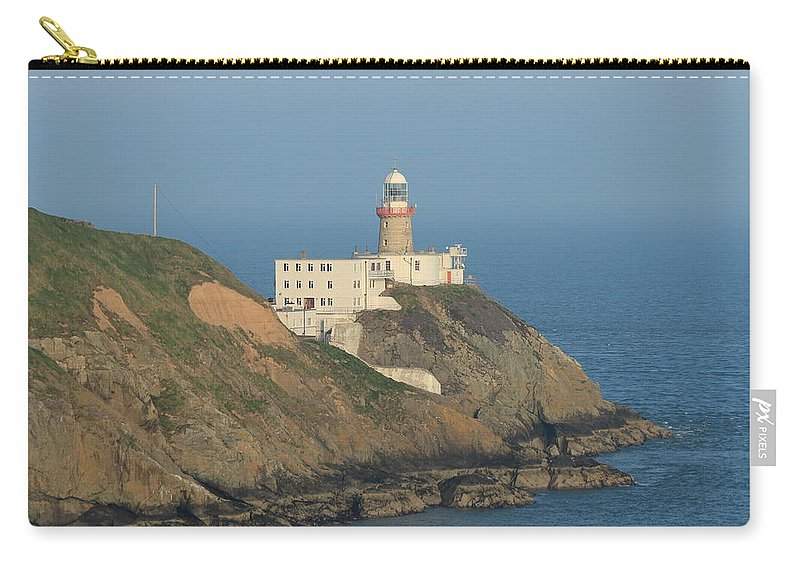 Baily Lighthouse Carry-all Pouch featuring the photograph Baily Lighthouse Howth by Robert Phelan