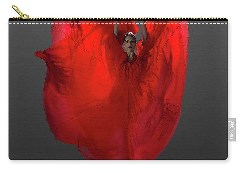 Ballet Dancer Carry-all Pouch featuring the photograph Ballerina On Pointe With Red Dress by Nisian Hughes