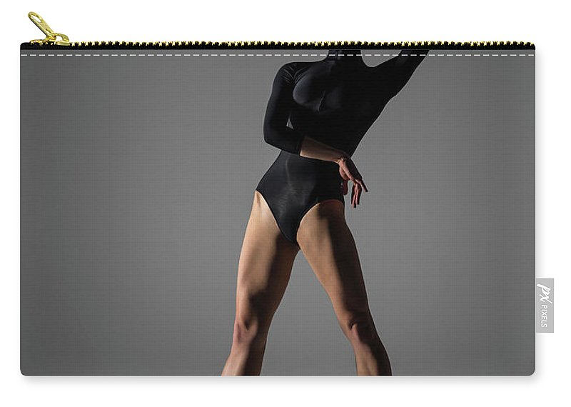 Ballet Dancer Carry-all Pouch featuring the photograph Ballerina Performing Relevé On Point by Nisian Hughes