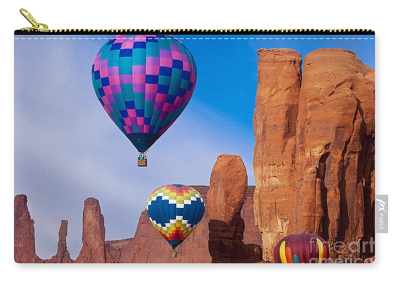 3 Sisters Carry-all Pouch featuring the photograph Balloon Festival In Monument Valley by Brian Jannsen