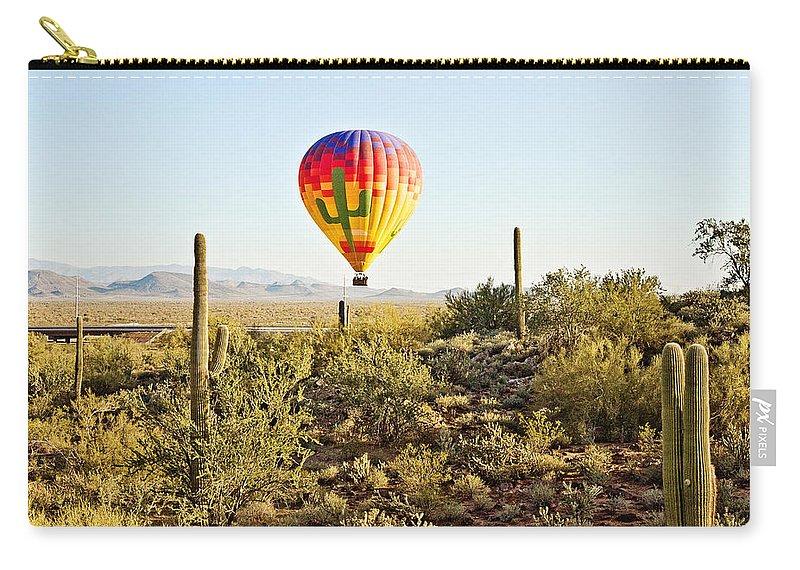 Hot Air Balloon Carry-all Pouch featuring the photograph Balloon Ride Over The Desert by Scott Pellegrin