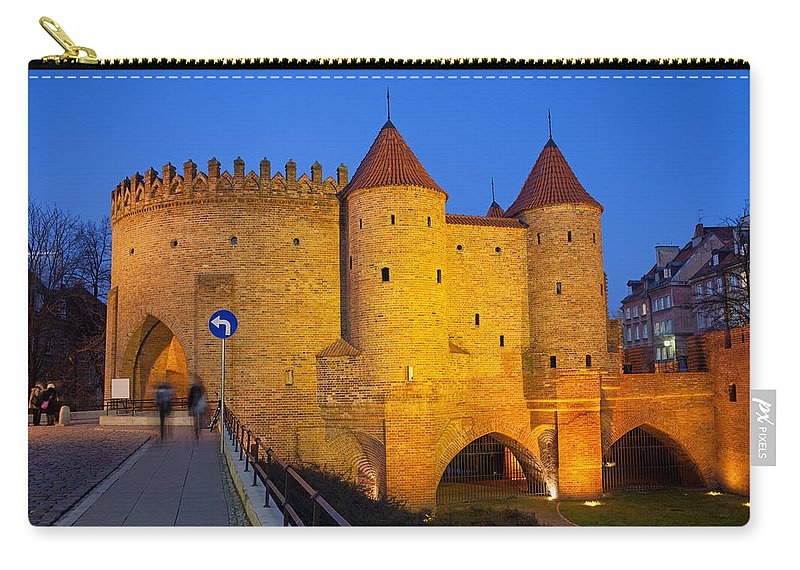 Warsaw Carry-all Pouch featuring the photograph Barbican At Night In The Old Town Of Warsaw by Artur Bogacki