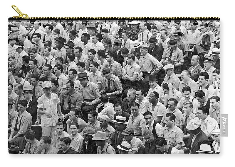 1956 Carry-all Pouch featuring the photograph Baseball Fans In The Bleachers At Yankee Stadium. by Underwood Archives