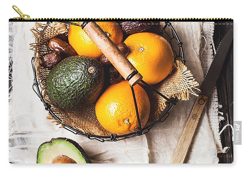San Francisco Carry-all Pouch featuring the photograph Basket With Avocado, Oranges And Dates by One Girl In The Kitchen
