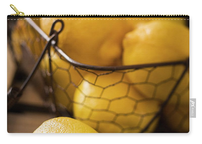 Vitamin C Carry-all Pouch featuring the photograph Basket With Organic Lemons Fresh From by Gmvozd