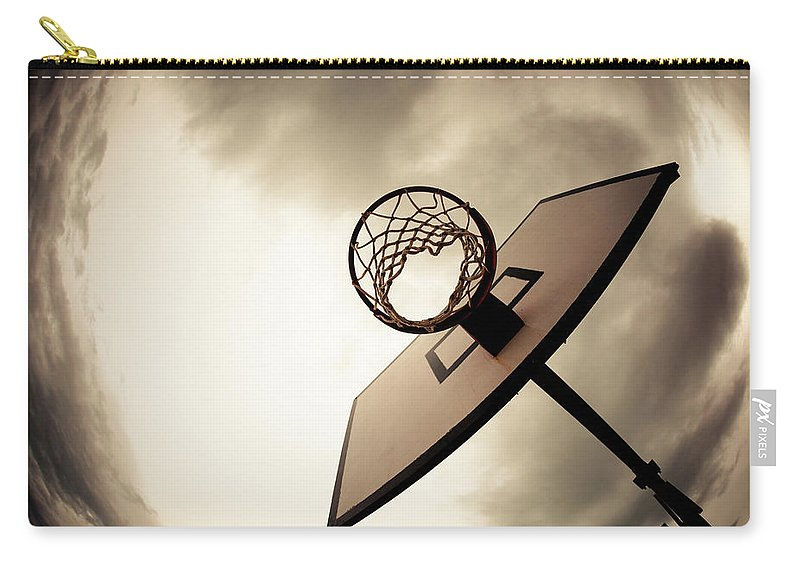 Goal Carry-all Pouch featuring the photograph Basketball Hoop, Dramatic Sky by Zodebala