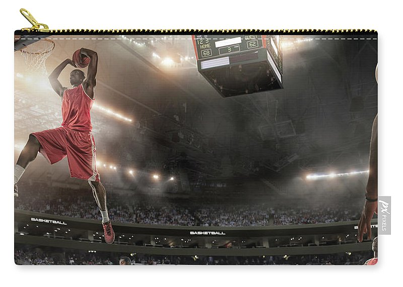Goal Carry-all Pouch featuring the photograph Basketball Player About To Slam Dunk by Peepo