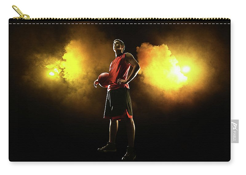 People Carry-all Pouch featuring the photograph Basketball Player On Smoky Yellow by Stanislaw Pytel