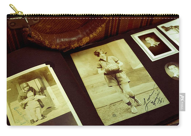 Album Carry-all Pouch featuring the photograph Battered Suitcase Of Antique Photographs by Amy Cicconi