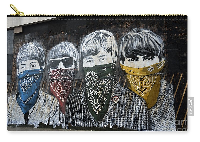 Banksy Carry-all Pouch featuring the photograph The Beatles wearing face masks street mural by RicardMN Photography