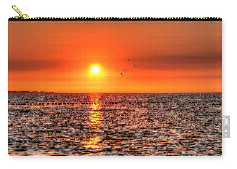 Baltic Sea Carry-all Pouch featuring the pyrography Beauty Sunset by Steffen Gierok