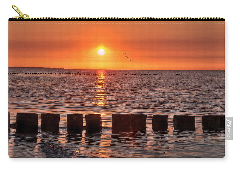 Ostsee Carry-all Pouch featuring the pyrography Beautyful Sunset by Steffen Gierok