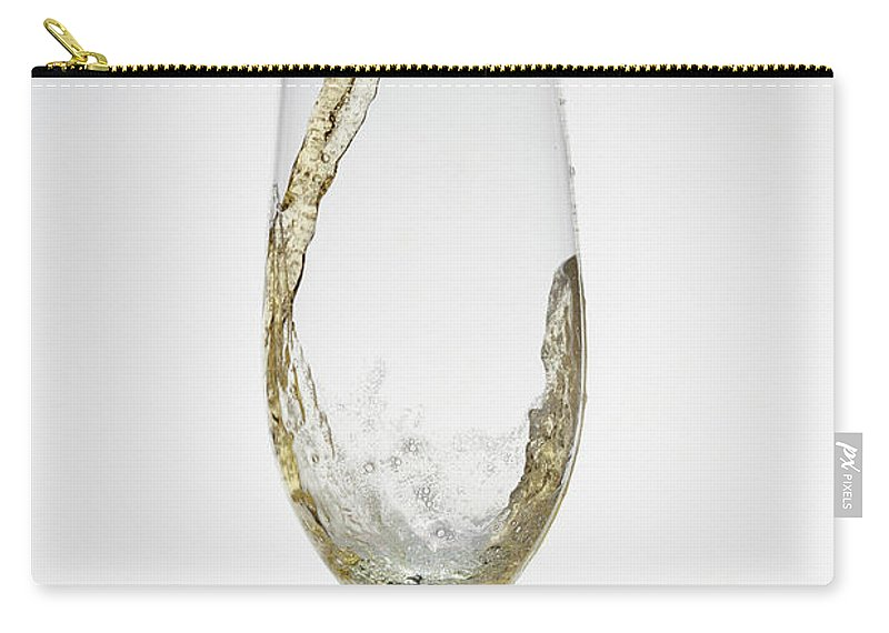 Alcohol Carry-all Pouch featuring the photograph Beer Being Poured Into A Glass by Dual Dual
